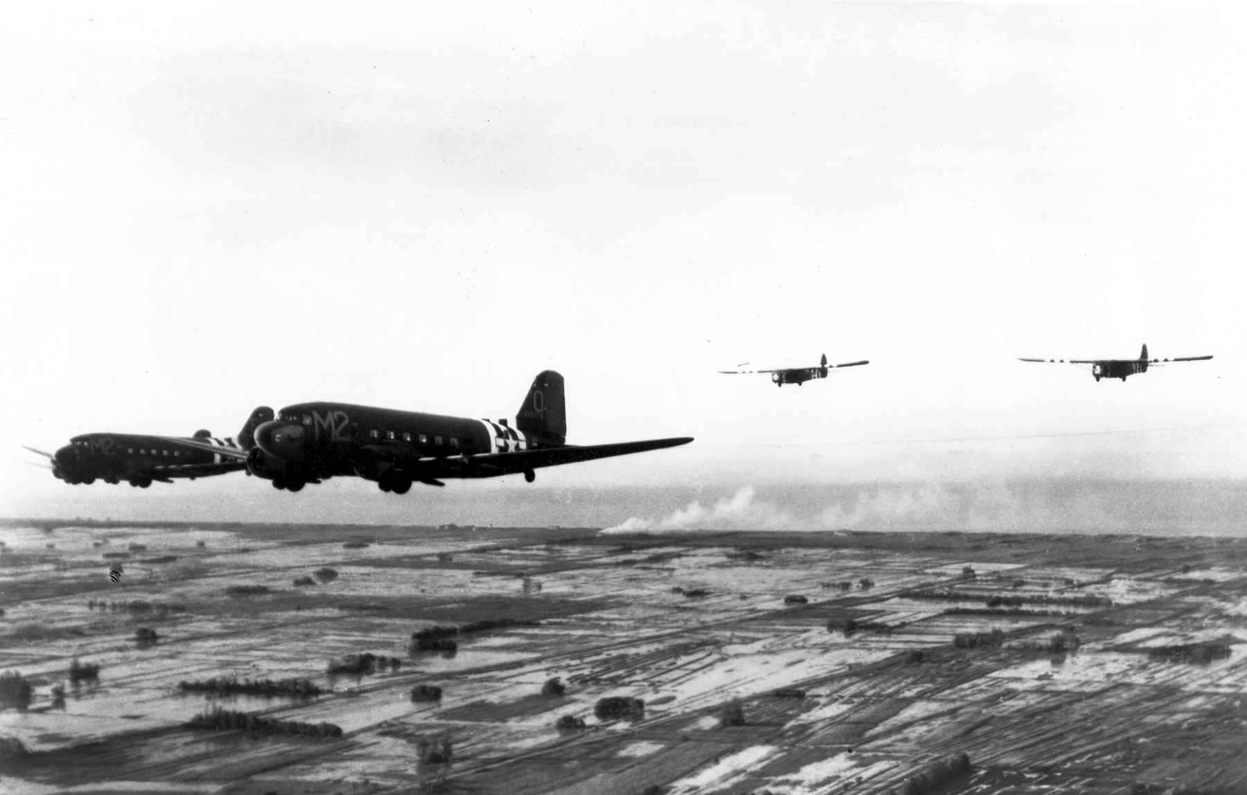 C-47As tow gliders over Normandy in June 1944