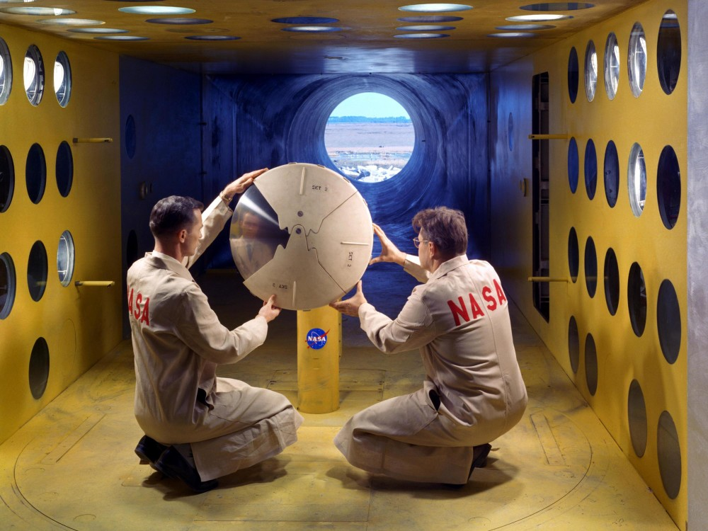Project Fire explored the intense heat of atmospheric reentry and its effects on would-be spacecraft materials. Although the ultimate tests involved Atlas rockets carrying recoverable reentry packages, the flight tests from Cape Canaveral were preceded by a series of important wind-tunnel tests at Langley. Here technicians ready materials for a high-temperature wind tunnel test. Credit: NASA