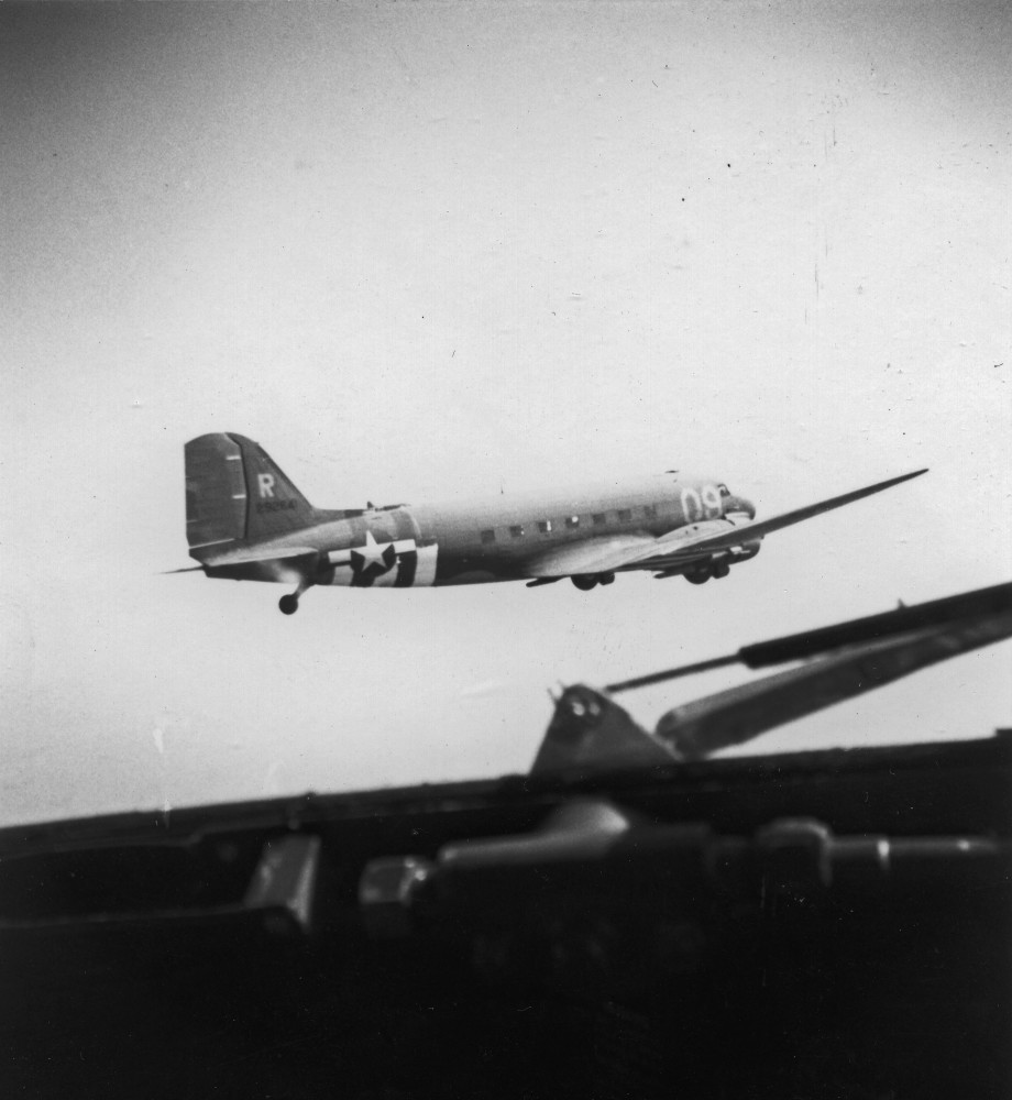 This photo of Turf & Sport, taken later during Market-Garden, shows how tight the formations were flown during combat missions. The shadow in the lower right hand corner is the windshield wiper on the pilot's side of the cockpit of the photographer's airplane.