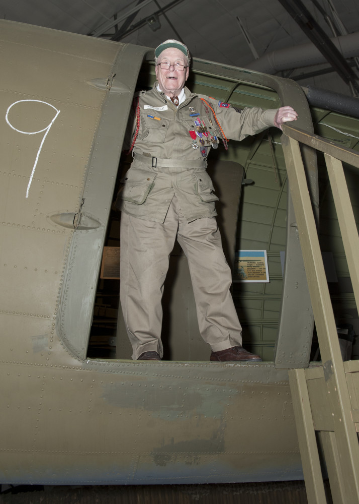 George Shenkle stands in the troop doorway of a C-47A Skytrain April 18, 2015, at the Air Mobility Command Museum near Dover Air Force Base, Del. Shenkle jumped out of this exact door on D-Day, June 6, 1944, over Sainte-Mère-Église, France. (U.S. Air Force photo/Airman 1st Class Zachary Cacicia)