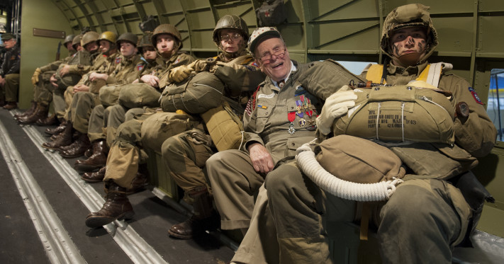 George Shenkle sits with re-enactors, who are depicting World War II-era paratroopers from the 82nd Airborne Division, inside a C-47A Skytrain April 18, 2015, at the Air Mobility Command Museum near Dover Air Force Base, Del. Shenkle is sitting in the same seat position on the very aircraft that he jumped out of on D-Day, June 6, 1944, over Normandy, France. (U.S. Air Force photo/Airman 1st Class Zachary Cacicia)