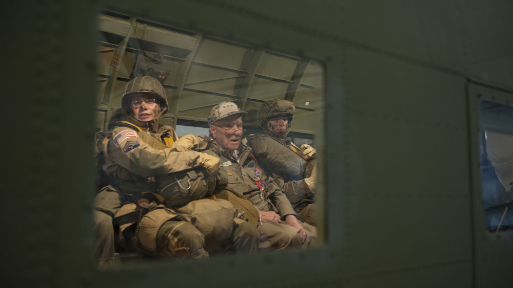 George Shenkle sits in between Daniel Dillier and Christian Holland, re-enactors depicting World War II-era paratroopers from the 82nd Airborne Division, onboard a C-47A Skytrain April 18, 2015, at the Air Mobility Command Museum near Dover Air Force Base, Del. (U.S. Air Force photo/Airman 1st Class Zachary Cacicia)