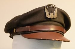 aeea354a1af This olive drab service cap is the same one worn by army and army air force  personnel ...